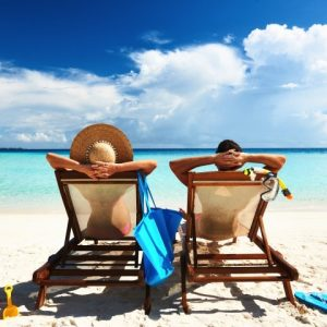 Couple-relaxing-in-beach-chairsS